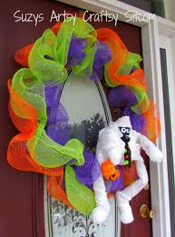 halloween diy mummy wreath with recycled paper towel tubes