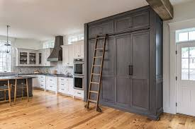 gray kitchen floors with oak cabinets gray oak cabinets with ladder on rails transitional