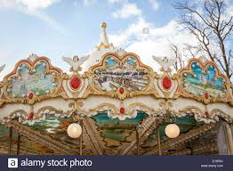 ornate painted metal frame of a vintage carousel or