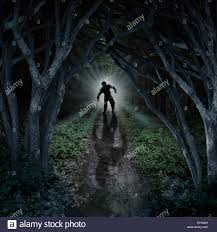 halloween monsters background horror monster walking in a dark forest as a scary fantasy concept