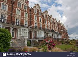 terrace of victorian style multi storey beachfront houses bexhill