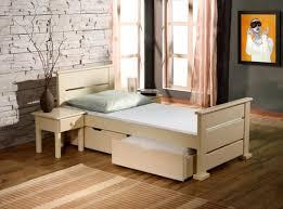 chambre enfant bois massif lit enfant bois massif avec 2 tiroirs sur roulettes et sommier inclu