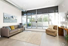 living room with sliding glass door to balcony artwork from