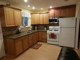 kitchen marvelous kitchen color ideas with light oak cabinets cream and brown tile back splash combined with brown wooden cabinet also brown marble top on