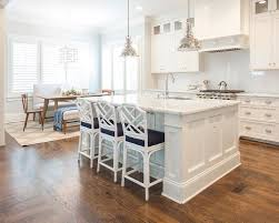 white kitchen island with seating island with white bamboo stools transitional kitchen