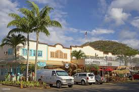 cars and stores at shore marketplace haleiwa shore