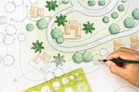 landscape architect designing on site plan stock photo image