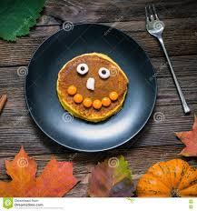 halloween pancakes sweet halloween food pumpkin pancakes for kids stock photo