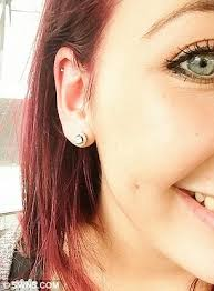 earrings on top of ear student loses part of ear when 10 piercing becomes so badly
