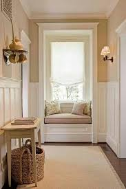small hallway design with ornaments and white walls and lightbox