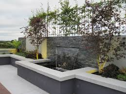 contemporary enclosed patio with walls inset with stone panels and