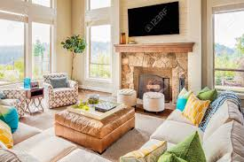furnished living room in new luxury home with fireplace ottoman
