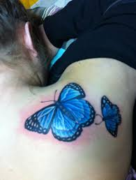blue butterfly on sholder design of tattoosdesign of tattoos