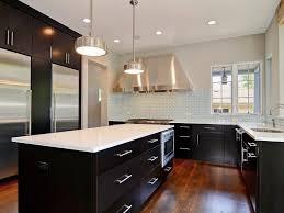 light floors dark cabinets yellow pendant lamps what countertop