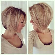 hair style angled toward face short medium angled bob haircut reverse bob blonde highlight