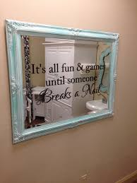 distressed vintage mirror with fun nail salon saying added in