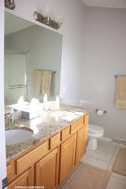 organized bathrooms and housewarming gift ideas embellishmints moving into our first home got thinking about great housewarming gift ideas that