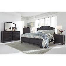 solid wood queen storage bed with 2 footboard drawers by signature