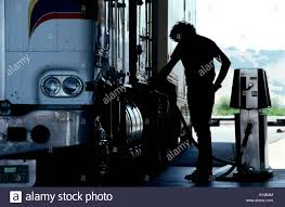 Fuel Truck Driver Independent Truck Driver Fills His Diesel Simi Truck With Fuel At
