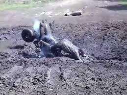 white jeep stuck in mud man driving atv falls into mud jukin media