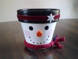 snowman painted clay pot with red scarf 12 00 via etsy i