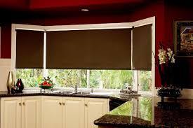 pink window blinds used in corner kitchen windows against kitchen