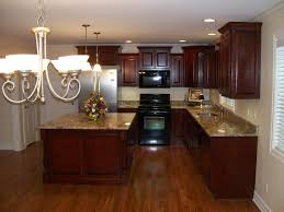 scenic dark finished mahogany cabinets with chandelier as well as