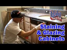 how to darken white cabinets using glaze to highlight cabinets tips refinishing or painting kitchen cabinets