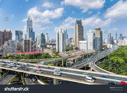 Modern City by Shanghai Highway Overpass Modern City Skyline Stock Photo