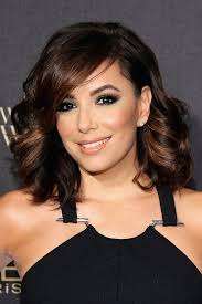 women curly haircuts for latina eva longoria s curly hair at 2015 women of worth event popsugar