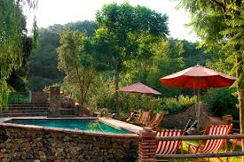 a rustic cottage in the sierra de aracena with a pool