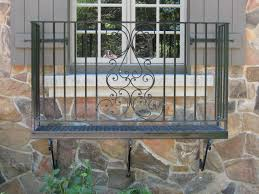 modish small home balcony covering glass window panel with carved
