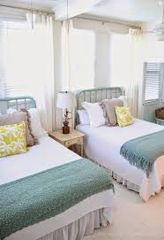 Ocean Themed Home Decor by Bright And Beach Themed Twin Beds In A Guest Room Decoist Twin