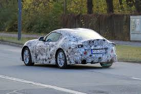 2018 toyota supra spied with less camouflage apparel