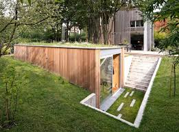 backyard architecture tiny green roofed atelier sinks into a leafy backyard in belgium