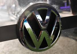 german volkswagen logo vw aims at ride pooling market with all electric minibus