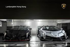 Lamborghini Veneno Front - two lamborghini veneno roadsters pose in hong kong