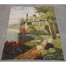 needlepoint tapestry town along riverside