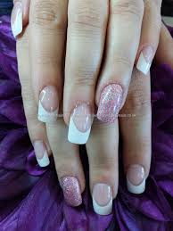 white french tips with acrylic overlay and pink glitter ring