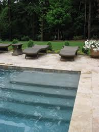 pool renovation travertine coping pebble sheen in blue granite