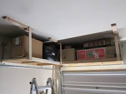 simple diy custom wood mounted garage ceiling storage shelves for