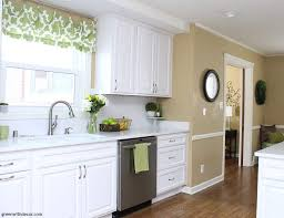 green and white kitchen cabinets white kitchen cabinets camelback walls green accents window valance