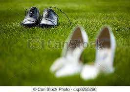 wedding shoes for grass groom and wedding shoes in the grass field stock image