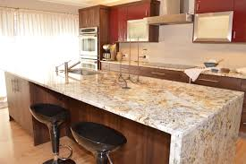 granite island kitchen a waterfall edged granite island is fabricated for a clean modern