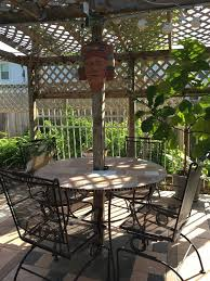 upcycled patio table with tiles hometalk