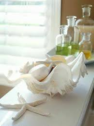 decorating bathroom ideas with seashell bowl display decorating