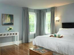 blue painted bedrooms woodsy bedroom theme floor to ceiling curtains bedroom farmhouse
