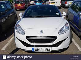 sport car peugeot white peugeot rcz compact sports car in car park space penzance