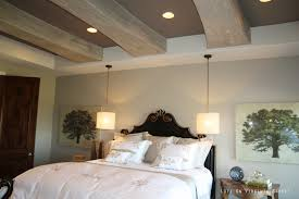 bedroom beige bedroom with blue accents wooden paneled wall and