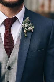a boho country wedding with native flowers navy groom suits
